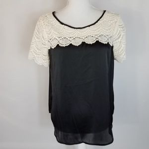 LC Lauren Conrad Black and Ivory Pullover Top L